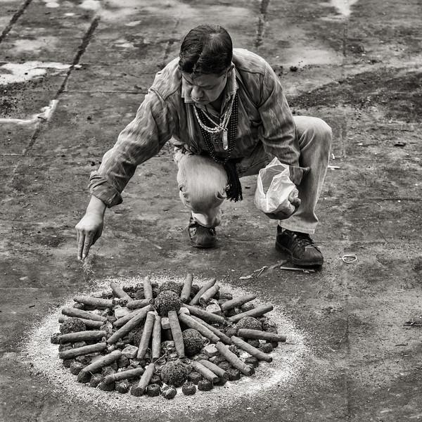 Shaman constructing a sacrificial pyre,Temple of St. Simon (Maximón), San Andrés de Itzapa, Guatemala
