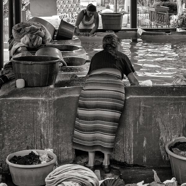 Woman Washing Laundry at Communal Pool, Guatemala