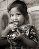 Weaver Girl Eating Tortilla, Guatemala