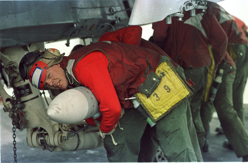 In the Red Sea- Aboard the John F. Kennedy- Aircrews prepare for a raid against Iraq. warfare, planes, Aircraft carrier, jets, launch, HARM missles. Photo by Todd Buchanan ©1991