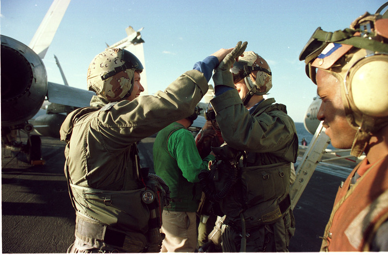 In the Red Sea- Aboard the USS John F. Kennedy- Pilots cheer after returning  from a raid against Iraq, warfare, planes, Aircraft carrier, jets, launch, Photo by Todd Buchanan ©1991