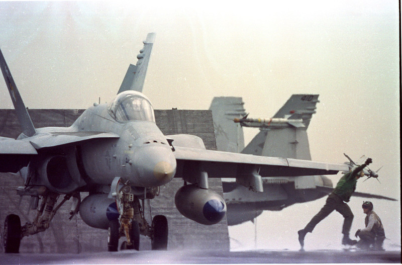In the Red Sea- Aboard the USS Saratoga- Aircrews prepare for a raid against Iraq. F/A-18 Hornet, warfare, planes, Aircraft carrier, jets, launch, Photo by Todd Buchanan ©1991