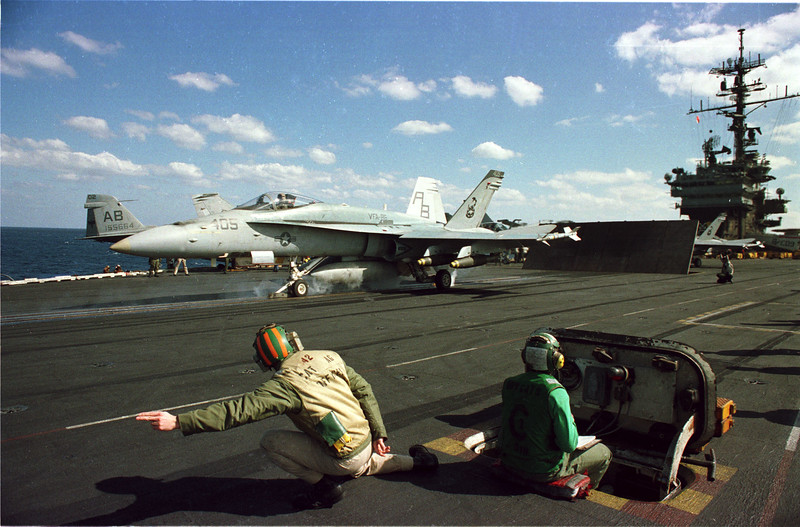 In the Red Sea- Aboard the USS America- Aircrews launch f/A-18's in preparation for a raid against Iraq, warfare, planes, Aircraft carrier, jets, launch, Photo by Todd Buchanan ©1991