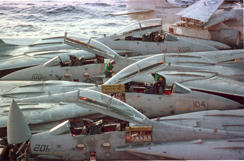 In the Red Sea- Aboard the John F. Kennedy- Aircrews prepare for a raid against Iraq. F-14 Tomcats, warfare, planes, Aircraft carrier, jets, launch, Photo by Todd Buchanan ©1991