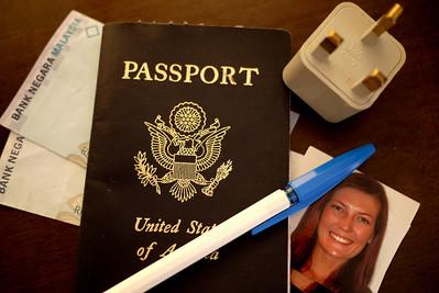 Tools for a visa run: Passport, money, converter, photos, and a pen!