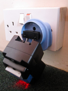 A very wonky way to charge my camera battery - capped off with some tape!