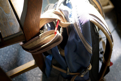 My laptop backpack and purse secured with a carabiner clip.