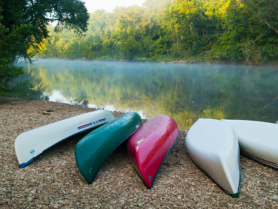 Canoes lined up at sunrise