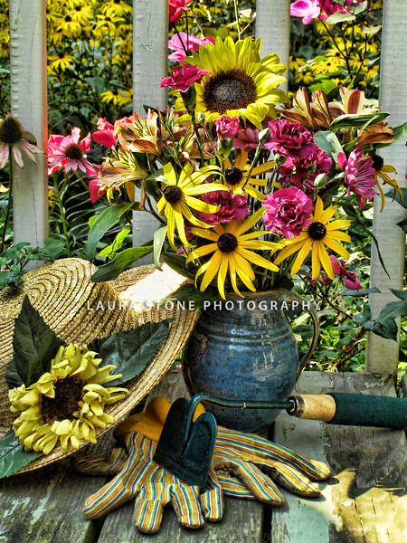 Late summer floral arrangement with gardening gloves