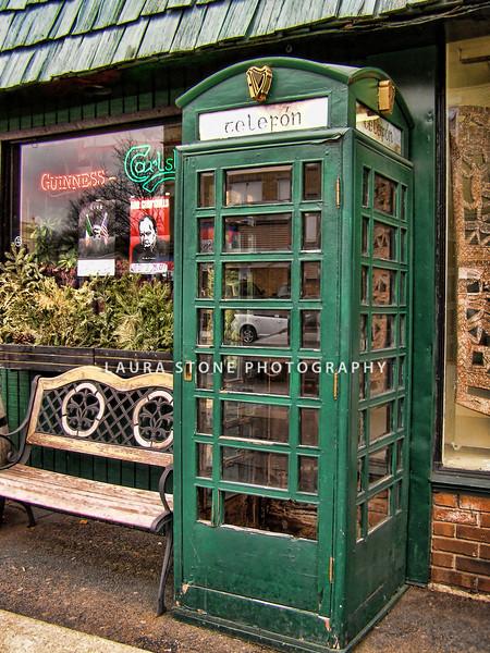 Phone booth at entrance to Irish Pub