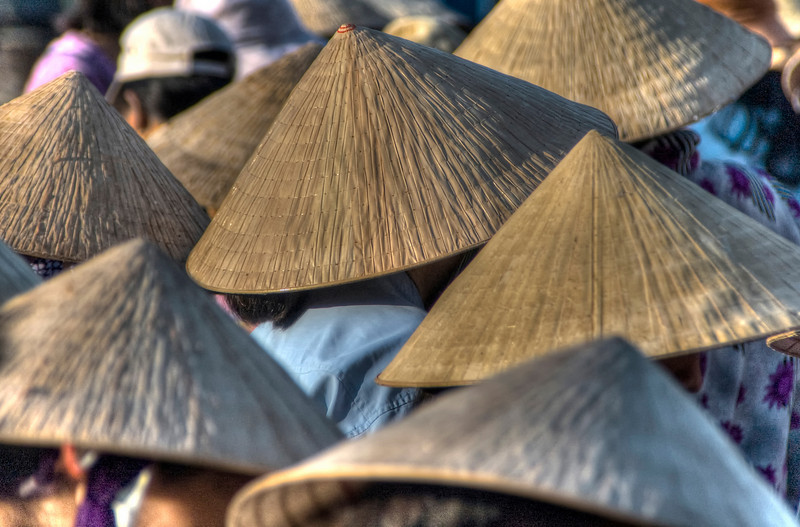 The traditional conical Vietnamese hat, the Non La, at the early morning fish market, Hoi An, Vietnam.