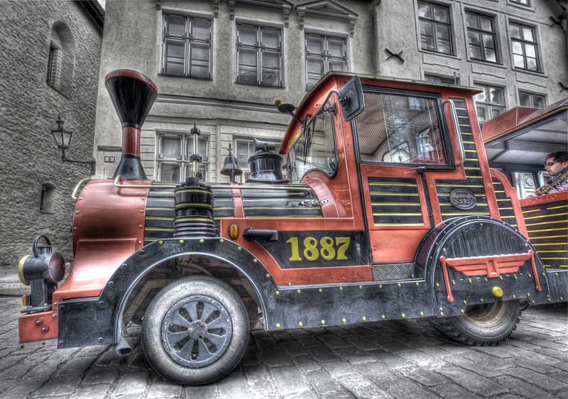 Tourist tram with sleeping driver, Tallinn, Estonia.