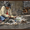 This lady sells and repairs utensils at a market south of Quito, Ecuador.