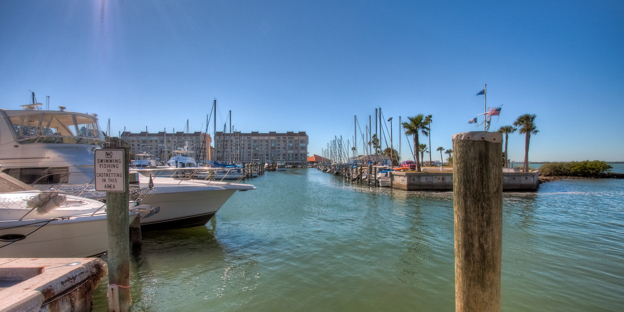 """Here is the HDR photograph of the scene (Dunedin Marina - Dunedin, Florida). All the previous exposures were combined using Photomatix software. This picture is closer to what we see using our eyes. Some HDR photographs can be surreal. Google """"HDR Photography"""" to see some incredible pictures."""