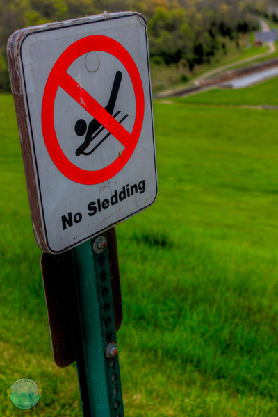 No Sledding<br /> I was kayaking by the dam that created East Fork Lake this evening.  The kayaking was rough in the cold brutal wind, but saw this sign on my way out.  The most amazing hill ever for sledding, as it is a steep hill that is the dam, but they of course allow no sleeding.