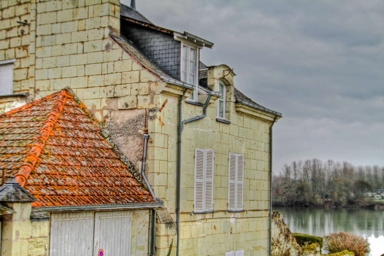 a house along the Loire river in Candes St Martin, Loire, France on a cold winter's day