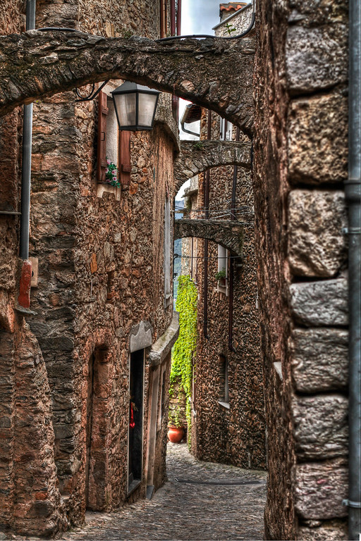 The narrow streets (walkways, really) in the village surrounding Castelvecchio Di Rocca Barbena in Liguria, Italy. This little village sits along La Strada del Vino E dell'Olio, an area best known for Vermintiono wines, excellent Pesto and high quality Olive Oil