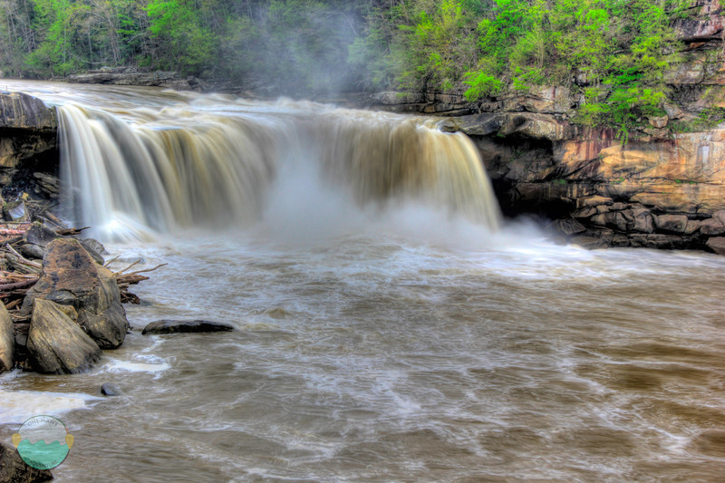 Flooding Cumberland<br /> Cumberland Falls as the river roars full of water and mist from the high water falls.  Would be so sweet to go over in a kayak right?