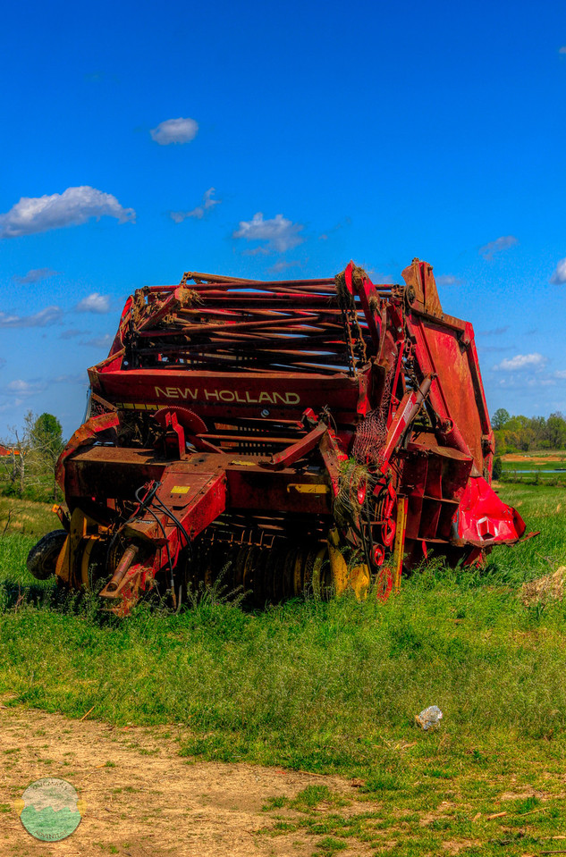 New Holland<br /> A piece of farm equipment that was left with no home for it to rest after the tornaado that ravished Peace Grove, Kentucky.  It was left to just sit in the open field.