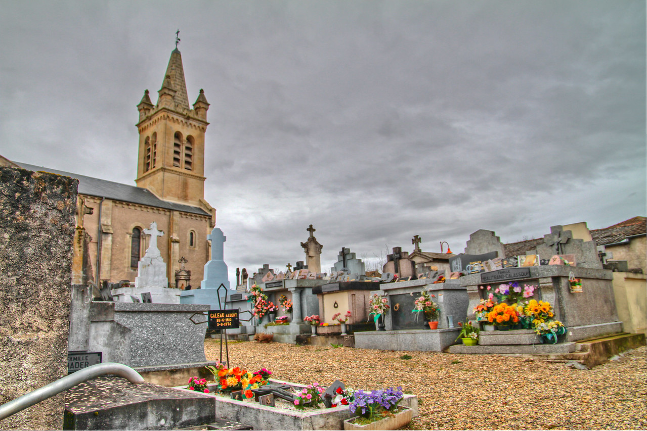 Driving back from Bordeaux early one Spring morning, we pulled off the road for a simple breakfast of coffee, jam, bread and fruit (€5) in a tiny town on the back roads going toward Aix, This HDR captures some of the flowers and the end-of-winter sky found in this tiny cemetery.