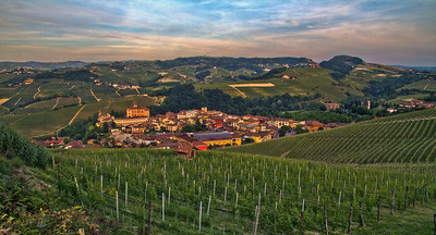 Sun sets on the small village of Barolo in this 3 exposure HDR, taken facing east, with Monforte d'Alba in very right rear of the image, tucked behind a small hill.