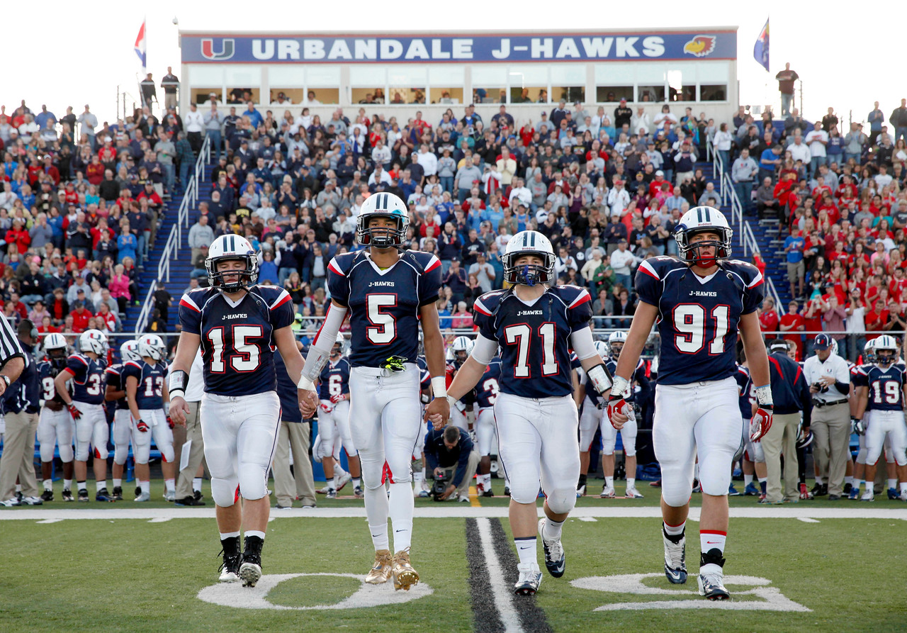 Urbandale's Allen Lazard (5) takes the field with teammates Logan Augustine (15), Alex Quirk (71) and Spencer Elbert (91)during the Urbandale High vs Dowling game held at Urbandale High School Sept 20, 2013  (Photo By/Conrad Schmidt)<br /> <br /> <br /> ONE TIME RIGHTS, NO REPRINT.  NO MAGAZINE.  SPEC RATE FOR MAGAZINE. email csfinefoto@gmail.com for magazine rate. <br /> <br /> <br /> ONE TIME RIGHTS, NO REPRINT.  NO MAGAZINE.  SPEC RATE FOR MAGAZINE. email csfinefoto@gmail.com for magazine rate.