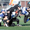 J.S.Carras/The Record  Hoosick Falls defenders tackle Rye Neck ball carrier Jakob Calvini (34) during first quarter of Class C high school state semifinal football action Saturday, November 23, 2013 at Dietz Stadium in Kingston, N.Y..