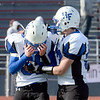 J.S.Carras/The Record  A dejected Hoosick Falls Thomas Peobody (l) is consoled bt teammate Shayne Richards (r) after being defeated 14-0 by Rye Neck during Class C high school state semifinal football action Saturday, November 23, 2013 at Dietz Stadium in Kingston, N.Y..