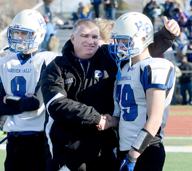 J.S.Carras/The Record  Hoosick Falls coach Ron Jones consoles Charles Hodge after being defeated by Rye Neck 14-0 during Class C high school state semifinal football action Saturday, November 23, 2013 at Dietz Stadium in Kingston, N.Y..