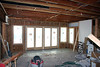 """Another view of Linda's studio, this time with flash to show the interior.  The section in which the windows are installed is a 5-foot extension (you can see a separation between the original concrete floor, and the green """"Warm-Floor"""", in which will be installed tubing to carry hot water to heat the floor (and room)."""