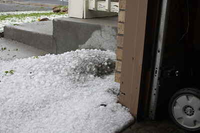 This is all hail and has not been shoveled into the corner, this is how Eric found it when he got home.