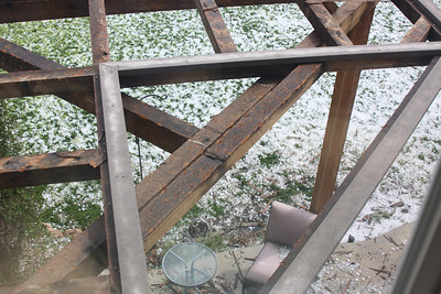 Top of the pergola, you can see all the marks from the hail.