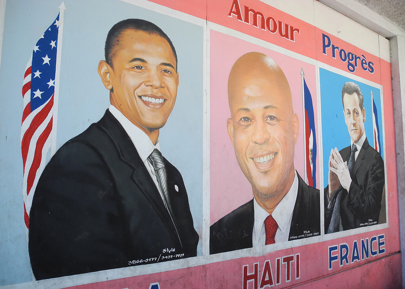 "Hand painted signs in Port-au-Prince. President Martelly, an ex-musician known as ""Sweet Micky"", sits comfortably with other heads of state."