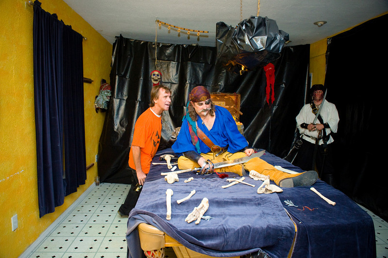 """photos by Dara Caudill  <a href=""""http://www.IslandPhotography.org"""">http://www.IslandPhotography.org</a>  Haley's Motel owners Sabine Musil-Buehler, and Tom Buehler hosted their 2nd annual """"Haleyween"""", featuring a Haunted Garden.   <a href=""""http://www.HaleysMotel.com"""">http://www.HaleysMotel.com</a>  To entertain younger visitors, Joan Carter from J&J Graphics  <a href=""""http://www.JNJGraphics.com"""">http://www.JNJGraphics.com</a>  played the scary witch, and Olga Martinez played the investigative reporter.  The Anna Maria Island Privateers  <a href=""""http://www.AMIPrivateers.org"""">http://www.AMIPrivateers.org</a> , along with many other volunteers, dressed as pirates & goblins to scare those old & brave enough to enter the Haunted Garden!"""