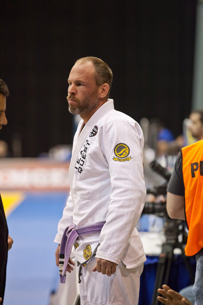 <h3> <font> <b> Tom Sperring, Portland, OR </b></font>  <br><br> I Began training Jiu Jitsu in the San Francisco Bay Area in 1998. I immediately fell in love with it and continued to train for over a year until a neck injury forced me off the mats. When I moved to Oregon in 2000, I joined Straight Blast Gym in Beaverton (currently Impact JJ). Training there was marred by injuries and so I decided to take time off to get healthy. After taking a few (too many) years off I decided to get back to it. Team Quest Fight Club, at that time was arguably the top MMA gym in the country/world and I lived 20 minutes from it. I decided to sign up at Quest and I threw myself into training and competing. At the time Quest did not offer any gi training so I trained in Submission Wrestling, kickboxing, and MMA. I entered my first Grappling tournament in 2005. I didn't do very well in that one, i actually remember tapping out in a loose triangle. Fabiano Scherner came on board in 2008 and began teaching Brazilian Jiu Jitsu at Team Quest. Since then I have focused entirely on BJJ and sub wrestling.  <br><br> I am currently a brown belt under Fabiano Scherner at Gracie Barra Portland.  <br><br> Competition record : <br><br>2013 NAGA Seattle NoGi adult/expert- gold, Gi heavyweight - bronze  <br>2012 IBJJF NoGi worlds senior 2/purple - heavyweight- silver medal <br>2012 IBJJF Pan Ams senior 2/purple - heavyweight- gold medal absolute- bronze medal <br>2010 Team Quest Invitational adult/blue - silver medal <br>2010 Revolution adult light heavyweight- gold medal <br>2010 Grappling X adult NoGi advanced - silver medal <br>2009 Oregon Open adult blue light heavyweight - silver medal <br>2009 Revolution adult blue light heavyweight - silver medal <br>2007 Subleague Qualifier NoGi adult light heavyweight - silver medal <br>2007 Western Regional Championship NoGi adult intermediate heavyweight - bronze medal <br>2007 Subleague Championship NoGi adult - 1st place <br>2007 Subleague Qualifier NoGi