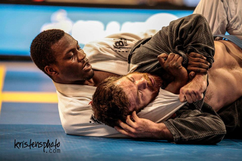 """<h3> <font> Dom Hoskins, San Diego, California.</font> <br><font> <br><br> """"Originally from the San Francisco Bay Area, Dom began his training under Cesar Gracie student Jon Santos in 2006. Already competing in football and track and field at the collegiate level at the time, Dom realized jiu jitsu was the perfect outlet for him, so he hung up his football pads and track spikes for good in order to pursue the art even further. <br><br> In 2009, after plenty of local tournament success and some MMA experience, Dom moved down to LA to finish the pursuit of his Merchandise Marketing Degree at the Fashion Institute of Design &amp; Merchandising. There, he trained under at Robot BJJ, an affiliate of Lotus Club BJJ, under the tutelage of Giva Santana, Tim Peterson, and David Telfer. He enjoyed more national success, taking home medals from various IBJJF tournaments and also graduated from FIDM! <br><br> In 2011, Dom relocated to San Diego in part because of his job but to also further his BJJ education in one of the meccas for the art. He currently resides there and trains/competes for BJJ Revolution Team under Rodrigo Medeiros, Stefano Aguiar, and Chris """"Cowboy"""" Kelbaugh. The training has elevated his game even further and Dom has found even more success at the national and international levels. He currently teaches kids and beginners classes at the school, and gets his own mat time as much as possible. Look for this name to continue to make podiums as he continues towards his goal of a world championship! If you would like to contact Dom, shoot him a buzz at dom.hoskins@gmail.com or his Facebook page, www.facebook.com/domhoskins. Below is a list of his accomplishments:"""" <br><br> 2013 FIVE Grappling California Invitational Participant (1 of 8 invited for the Purple Belt Open Division)  <br>2013 USBJJF American Nationals - Bronze <br>2013 IBJJF Las Vegas Summer Open - Bronze <br>2013 NAGA San Diego - Bronze <br>2013 IBJJF Las Vegas Spring Open - Bronze <br>2013 American C"""