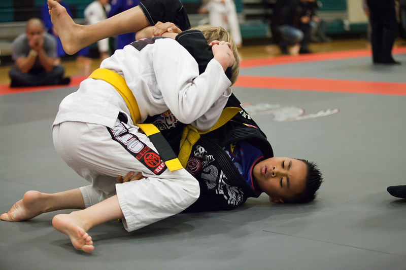 "<h3> <font><b> Austin Villanueva, Federal Way, WA  </b></font> <br><br> Austin is a 14-year-old Brazilian Jiu Jitsu practitioner. He was born and raised on the beautiful island of Guam. He began training BJJ in 2006 at Purebred Jiu Jitsu and earned his yellow belt under Professors Stephen Roberto / Mike Fowler and fell in love with the gentle art. He is currently a green/white belt with Gracie Barra Federal Way under Professors Shawn Joseph / Kevin Smith. His dad is in the Army and his family moved to Washington State in 2009.  Austin has been tearing up the NW scene medaling at every local event. He has recently earned a gold medal at the Pan Kids tournament this past February and more recently won 'Best Technique' at the Adamson Bros invitational Tournament. <br><br><a href=""https://www.facebook.com/AustinKyleVillanueva%20"" style=""color: #CC0033"">Please give Austin a LIKE on his FB Fan Page! </a> </h3>"