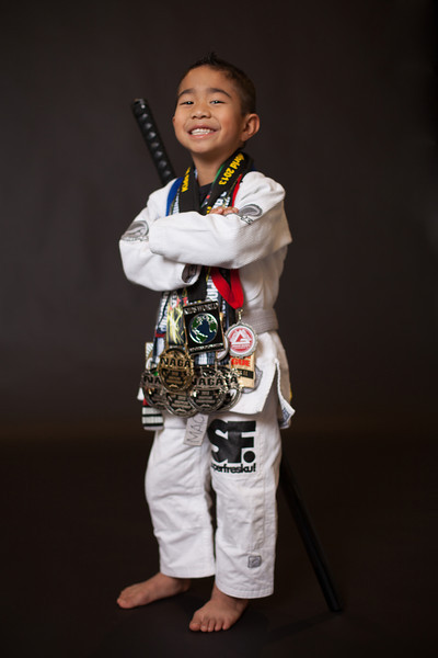 <h3> <font> <b> Jase Macatangay, Federal Way, WA </b></font>  <br><br> Belt:  Gray <br> Jase was born in Seattle, WA.  His family and roots are from the tiny island of Guam, where respect is a core cultural value that we incorporated into his everyday life.  At the young age of 5, it's very clear that Jase understands these values.   <br><br> Jase just started kindergarten this year (2013) and absolutely loves to go to school!  He has tried many sports at his young age: soccer, t-ball, basketball, and wrestling.  But his favorites are jiu-jitsu, soccer and basketball.   <br><br><b>How Jase's Jiu Jitsu journey began:</b> <br><br> Jiu jitsu was present in Jase's life since he was just 2 years old.  When his dad began to coach the kids program, Jase would always come with him to class and watch his sister, who is now a yellow belt, and the other children learn jiu jitsu.  One day (he was 4 years old by then) his dad asked him if he was ready to come on the mats, he hasn't stopped since.   <br><br> Jase's very first tournament outside of Gracie Barra was on April 13, 2013, at the Adamson Bros (Rafael Lovato Jr affiliate) Kids in house tournament in Seaside, Oregon where he won all his matches.  This is also where he met his very first sponsor, Kristensphoto.  He's been hooked ever since and has entered many local tournaments in the Pacific Northwest.  He loves to compete and always looks forward to the next tournament.   Competition Record: <br><br> May 2013GiGoldSubleague Qualifier 2Portland, OR <br>May 2013GiSilverNAGA SeattleBremerton, WA <br>May 2013NoGiSilverNAGA SeattleBremerton, WA <br>June 2013GiGoldSubleague ChampionshipPortland, OR <br>June 2013GiSilverGracie Barra Seattle In-houseSeattle, WA <br>July 2013GiGoldThe Revolution TournamentBonney Lake, WA <br>July 2013NoGiGoldThe Revolution TournamentBonney Lake, WA <br>July 2013NoGiSilverKids WorldSan Bernardino, CA <br>Sept 2013GiGoldOregon OpenPortland, OR <br>Sept 2013NoGiGoldOregon OpenPortland, OR <br>Sept 2