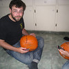 Unimpressed Oliver working on 1 of the 16 pumpkins to be carved