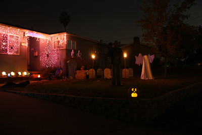 This is what our house appears like as you come up the driveway.  We have a graveyard, torches, various props and lighting, and a chilled fog machine (not active in the photo).