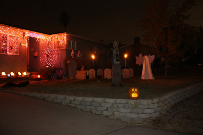 Here I added a flash fill in order to illuminate the grave digger.  On the left hand side, there is a black cloaked figure laying down.  We can trigger it with a remote to immediately stand up.  This really causes most of the trick or treaters to jump.