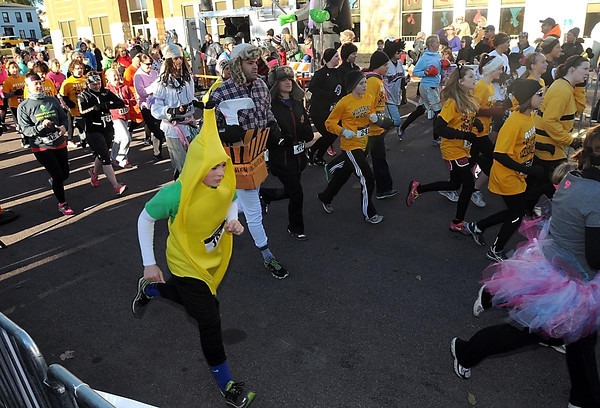 Pat Christman<br /> Costumed runners leave the start line during Saturday's St. Peter Halloween Fun Run.