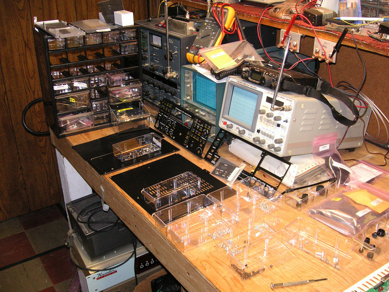 Sorry, this is not a picture taken at the HBQRP meeting site.  This is my basement work area.<br /> <br /> This is part of my Elecraft K3 kit spread all over my workbench.  Some of the parts are stored in the <br /> drawer rack in front of the service monitor.