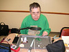 K0NEB working on his S-9 kit.  <br />  Notice that Joe is jumping ahead - he had the box and  'credit card insulator' already to go before the meeting!
