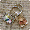 <b>Rectangular Keychain $110</b>  This silver-plated rectangular keychain is a perfect way to focus on those you love even while sitting in traffic. The rectangular photo keychain comes in horizontal or vertical formats and is attached to a high-quality split key ring.