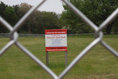 "A sign at the site of Mt. Pleasant's future dog park features the name ""Hannah's Bark Park"" as a tribute to Hannah Scalise at Mission Creek Woodland Park. The Central Michigan University student began the initiative to construct the park before she died of bone cancer in 2011."