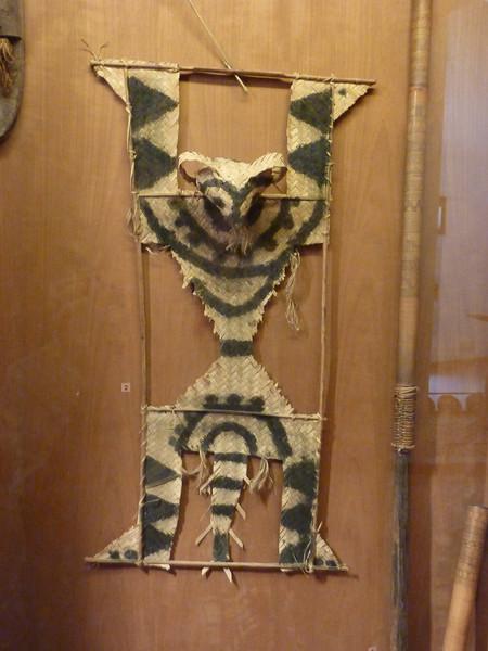 lemur (?)  woven grass scarecrow