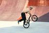 "Jason Plourde, a ""flatland"" BMX rider, performing a spinning and balancing maneuver"