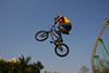 Olivier Brunelle flies high through the air with no feet on his bike