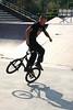 Jason Plourde, a flatland BMX rider, performing a spinning balancing maneuver